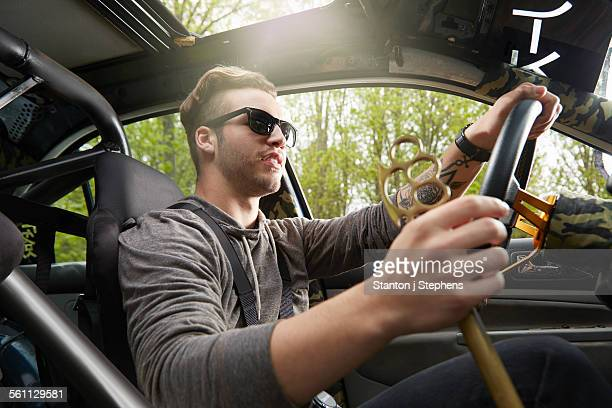 Portrait of man driving wearing sunglasses