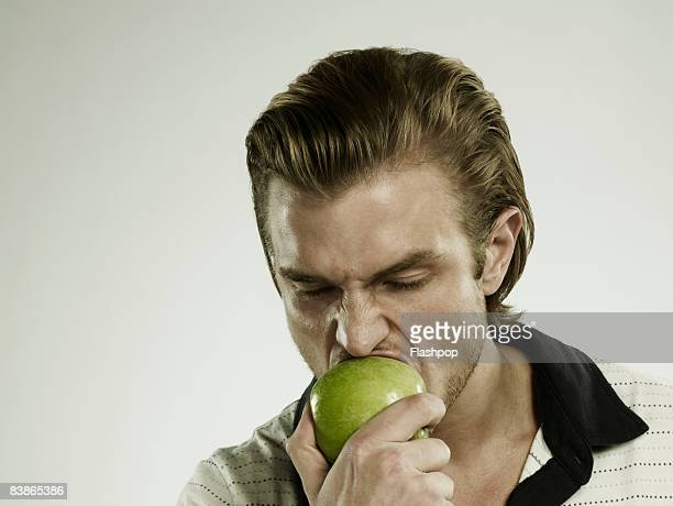 Portrait of man eating an apple