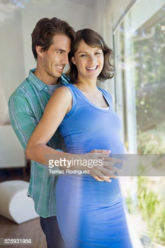 Portrait of man embracing pregnant woman : ストックフォト