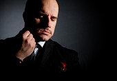 'Portrait of man, godfather-like character.'