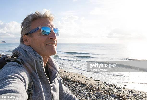Portrait of man hiking/biking on beach