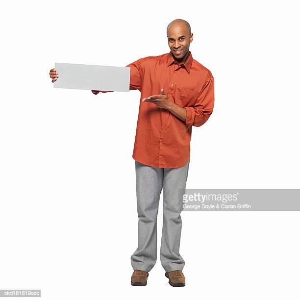 Portrait of man holding blank card