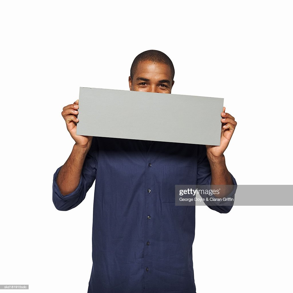 Portrait of man holding blank card : Stock Photo