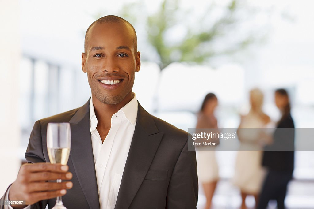 Portrait of man holding champagne flute : Stock Photo