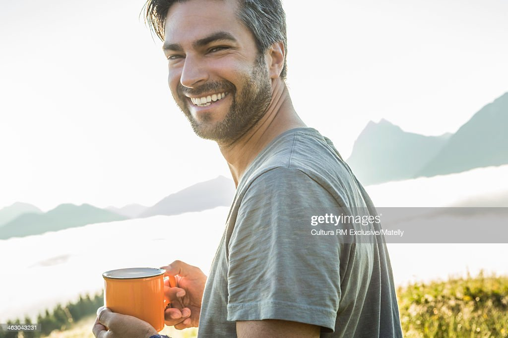 Portrait of man holding coffee, Tyrol, Austria : Stock Photo