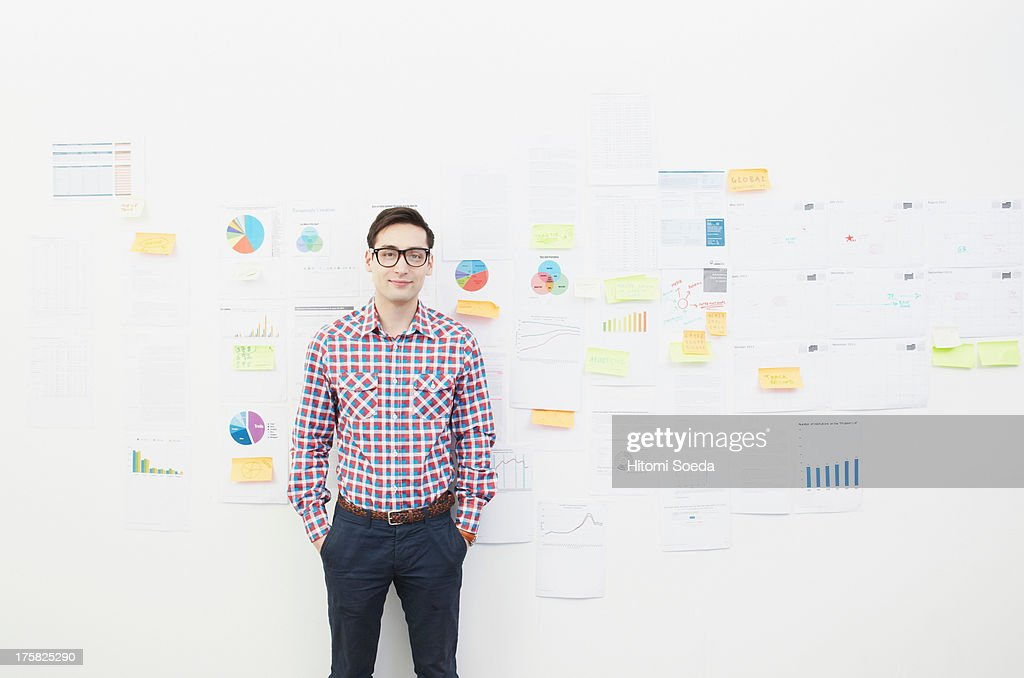 Portrait of man in front of wall with adhesive notes : Stock Photo