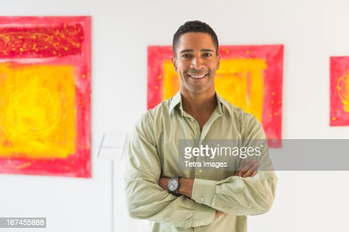 Portrait of man in modern art gallery : Stock Photo