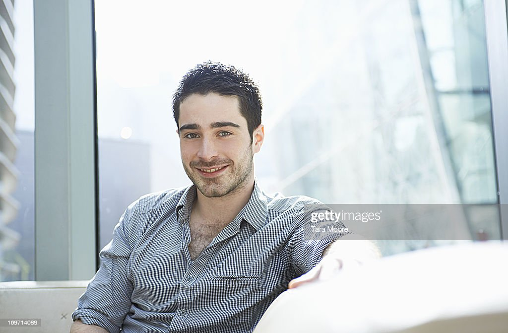 portrait of man in office smiling : Stock Photo