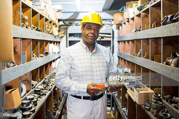 Portrait of man in plumbing stockroom with products