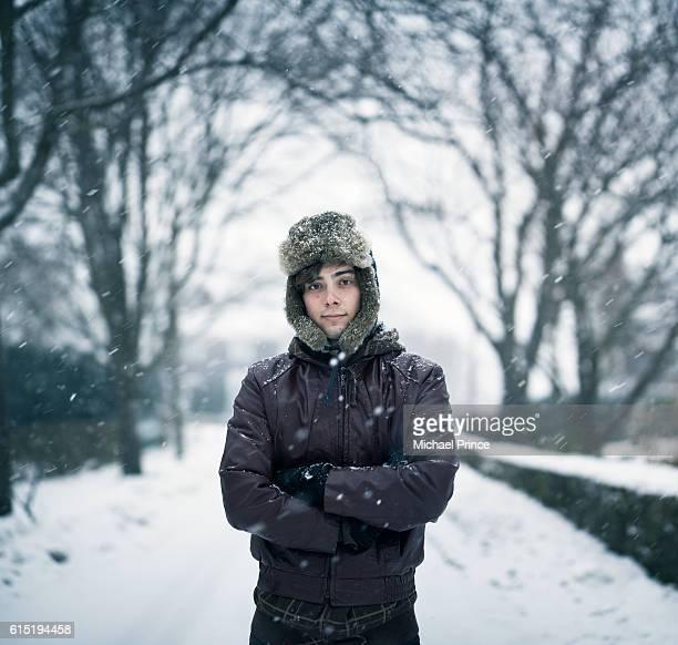 Portrait of man in snowy landscape