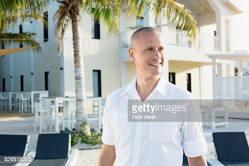 Portrait of man in tourist resort : Foto de stock