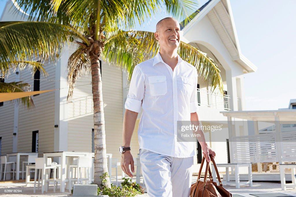 Portrait of man in tourist resort : Stockfoto
