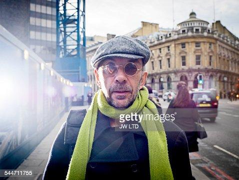 Portrait of man, in urban street