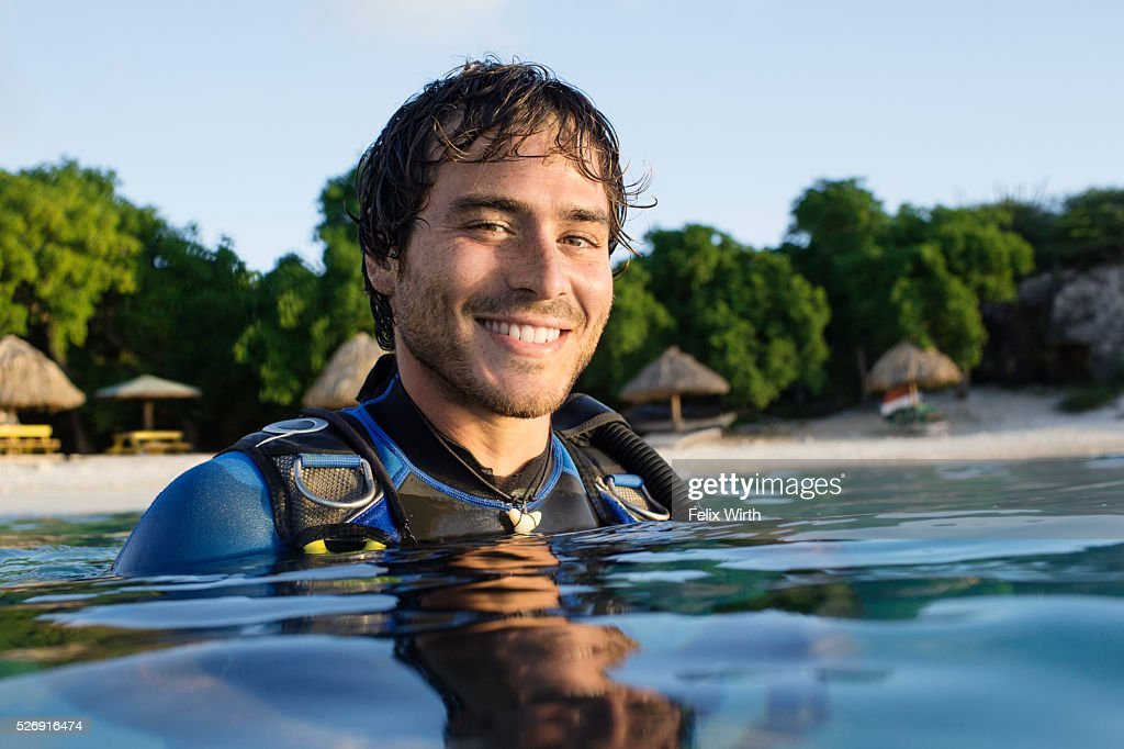 Portrait of man in wetsuit in sea : Stock-Foto