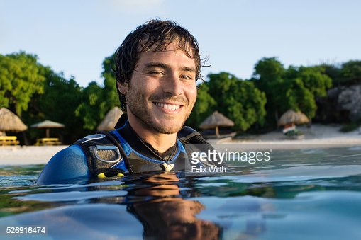 Portrait of man in wetsuit in sea : Stock Photo