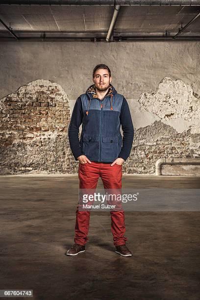 Portrait of man inside old warehouse