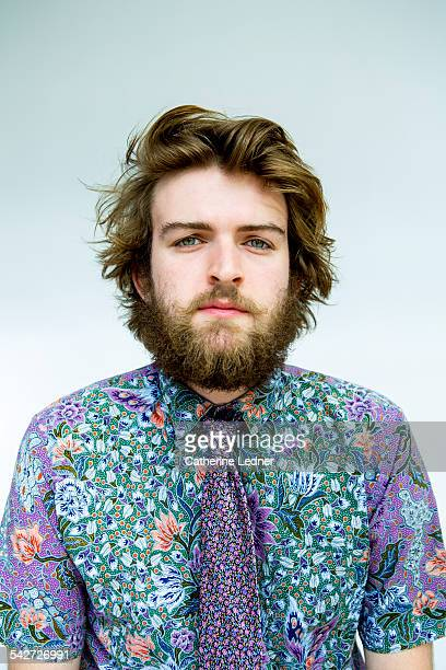 Portrait of man is colorful shirt and matching tie