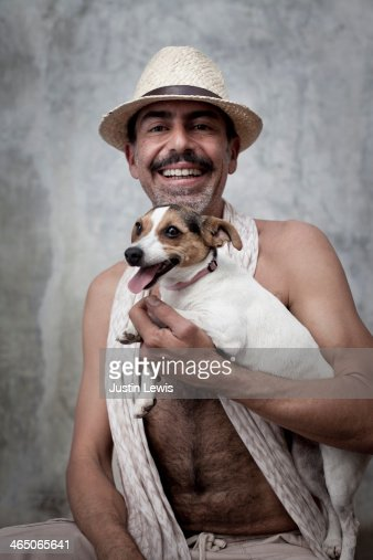 Portrait of man laughing holding small dog : Stock Photo