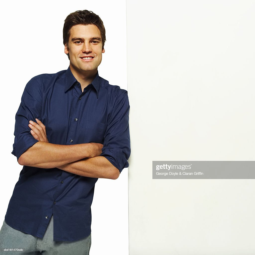 Portrait of man leaning against wall : Stock Photo