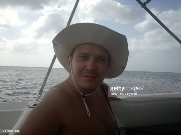 Portrait Of Man On Boat In Sea Against Sky