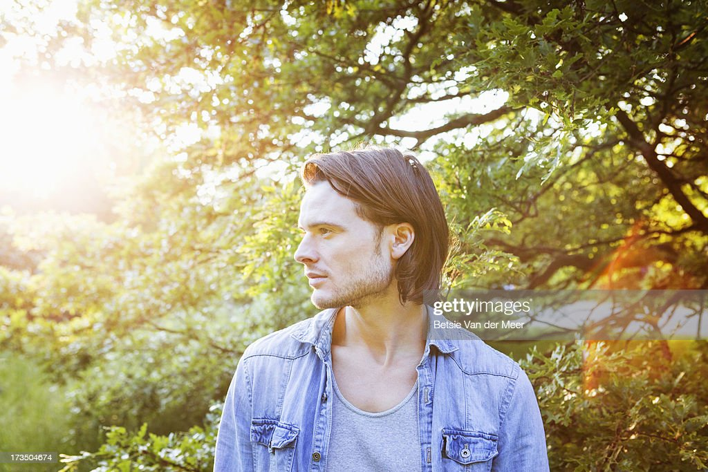Portrait of man outdoors in woods. : Stock Photo