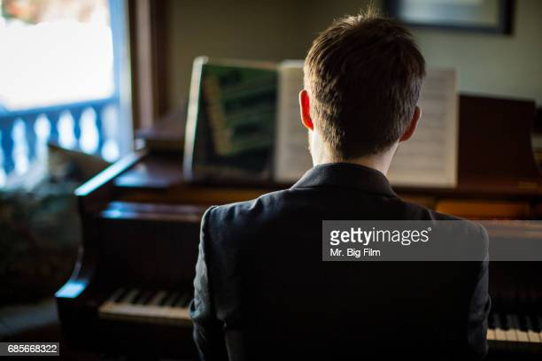 Portrait Of Man Playing Piano From Behind