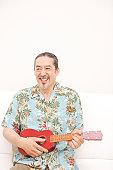 Portrait of Man playing ukulele