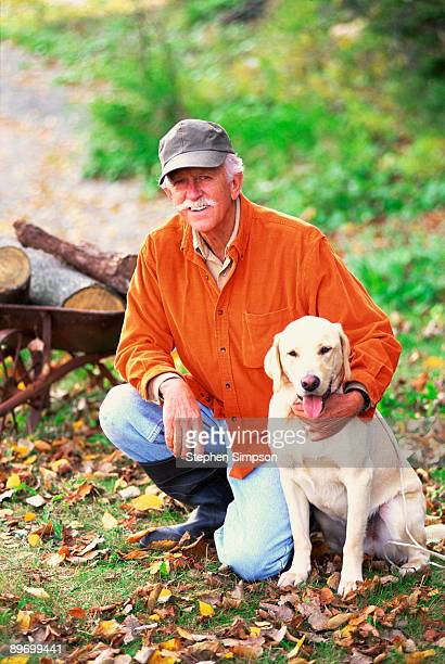 Portrait of man posing with pet dog