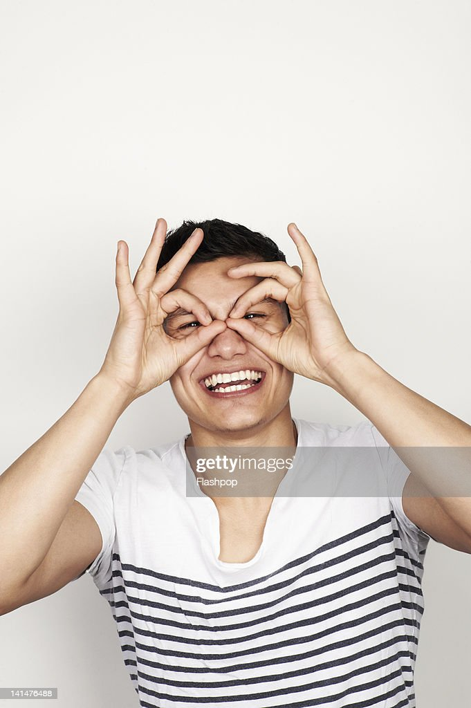 Portrait of man pulling a funny face : Stock Photo