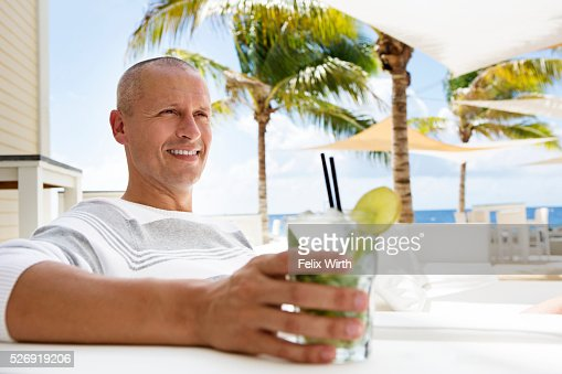 Portrait of man relaxing at cafe nearby beach : Stock Photo
