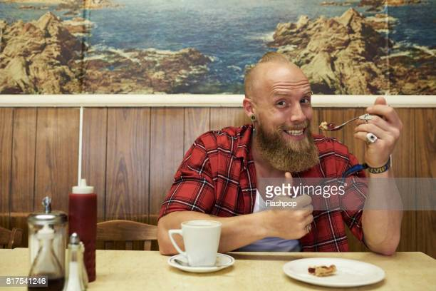 Portrait of man relaxing in a cafe
