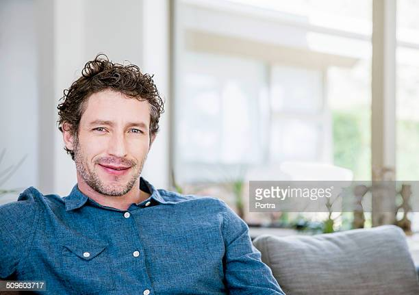 Portrait of man relaxing on sofa at home