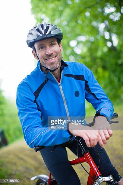 Portrait of man riding mountain bike in park