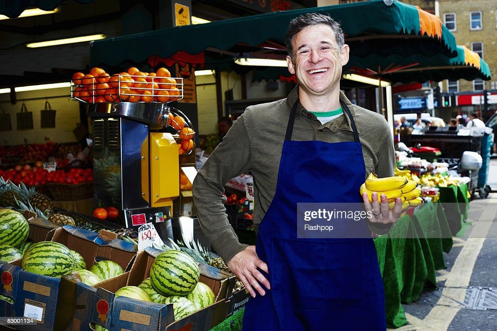 Portrait of man selling fresh food