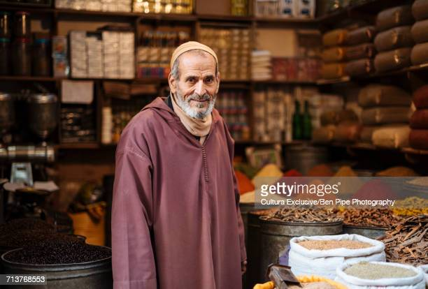 Portrait of man selling spices, Medina, Fes, Morocco, North Africa