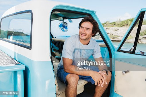 Portrait of man sitting in vintage pickup truck : Foto de stock