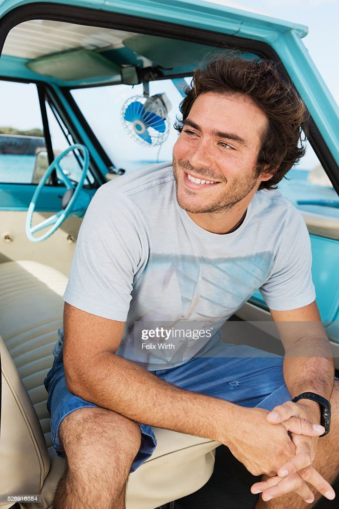 Portrait of man sitting in vintage pickup truck : Stock Photo
