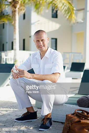 Portrait of man sitting on deck chair : ストックフォト