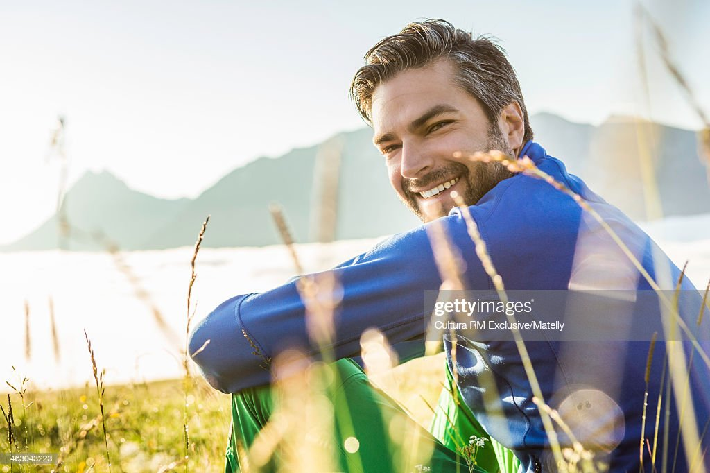 Portrait of man sitting on grass, Tyrol, Austria