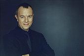 Portrait of man smiling in dark suit