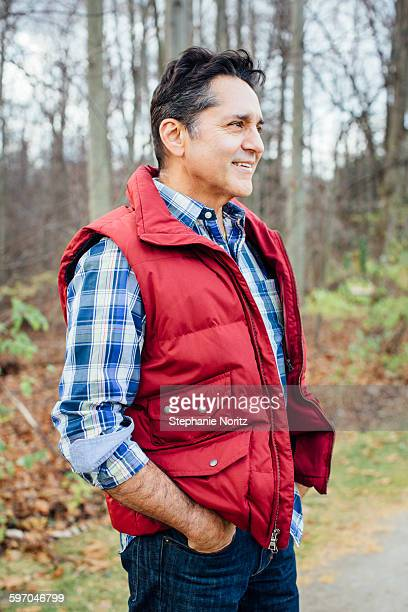 Portrait Of Man Smiling On Hike In Forest