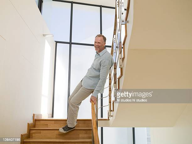 Portrait of man smiling on staircase