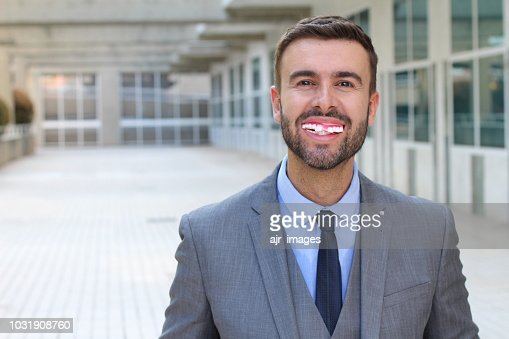 Man with a disgusting messy smile : Stock Photo