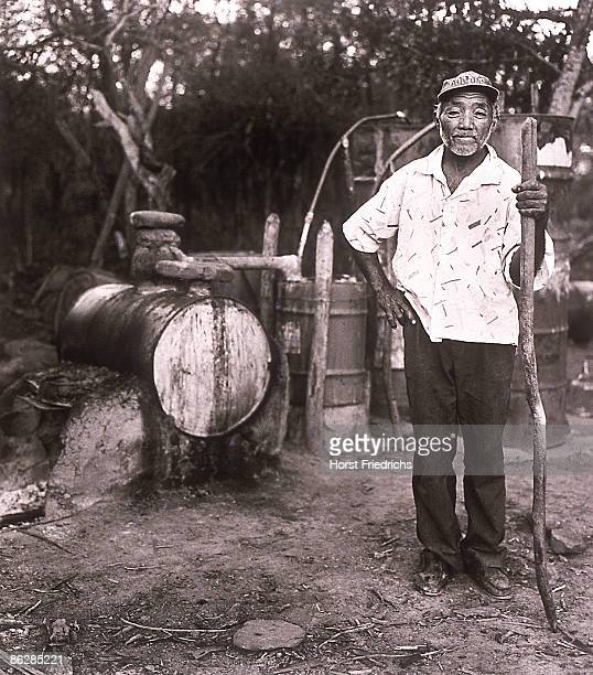 Portrait of man standing and holding long stick