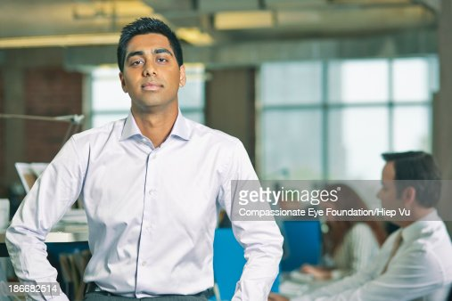 Portrait of man standing in office : Stock Photo