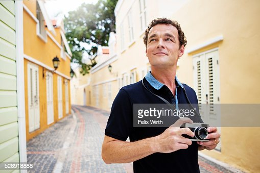 Portrait of man standing on narrow street : Foto de stock