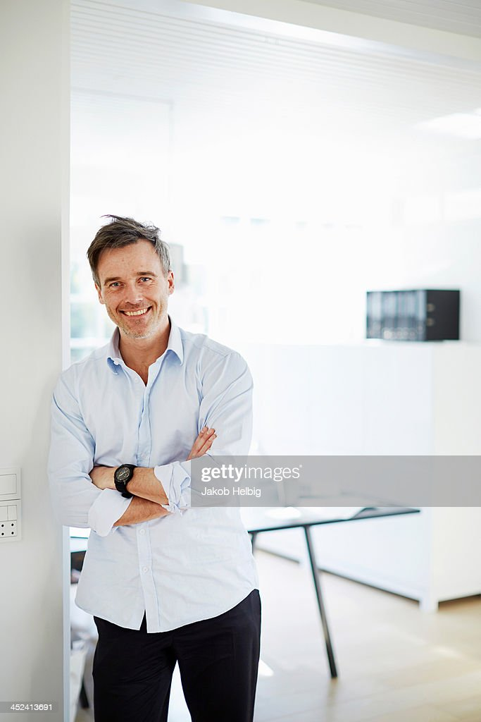 Portrait of man standing smiling : Stock Photo