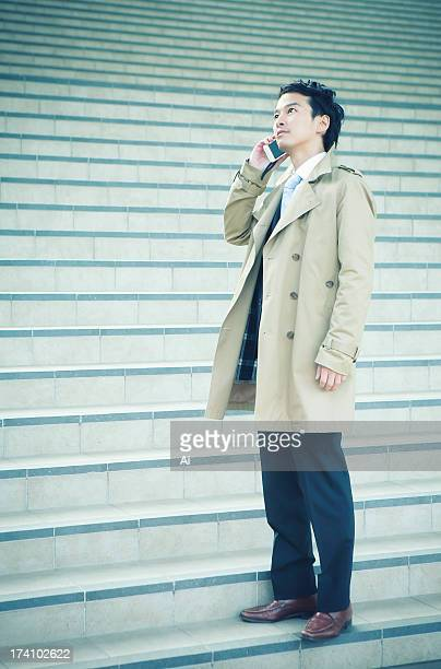 Portrait of man talking cell phone at the stairs