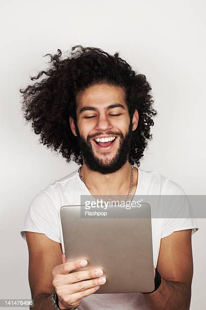 Portrait of man using digital tablet