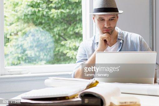 Portrait of man using laptop : Stockfoto